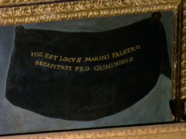 "Faliero's picture in the Great Council Hall. The black shroud painted in its place bears the Latin phrase, ""This is the space reserved for Marino Faliero, beheaded for his crimes."" Courtesy of Wikipedia."