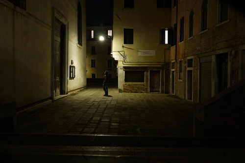 Nighttime staring at a street sign in Cannareggio