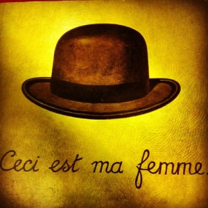 The cover image from Oliver Sack's 'The Man Who Mistook his Wife for a Hat'. The image is a nod to Magritte's famous painting The Treachery of Images (1929).