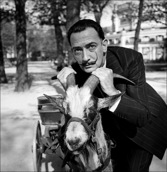 FRANCE - CIRCA 1953: Salvador Dali With A Goat In Paris, France In 1953 (Photo by REPORTERS ASSOCIES/Gamma-Rapho via Getty Images)