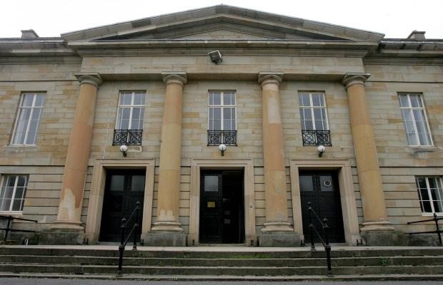 Modern Day Durham Crown Court. The building frontage appears entirely in fitting with the descriptions of executions from 1816 onwards. The square stone pegs where the scaffold supports sat still visible to the top left and top right of the central black door.