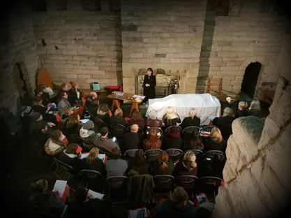 Dr Suzy Lishman demonstrating a criminal dissection at Newcastle's Castle Keep. Image courtesy of Newcastle Castle